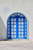 Typical blue door on the island of Santorini — Stock Photo