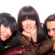 Stock Photo: Group of three girls laying