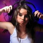 Girl enjoys music — Stock Photo
