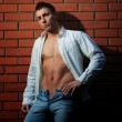 Fashion shot of a young handsome man in casual clothes - Stockfoto