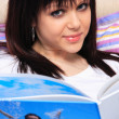 Stock Photo: Beautiful girl reads magazine
