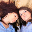Two brunette girls in bed — Stock Photo