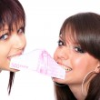 Two beautiful young girls with Euros — Stock Photo #9039121