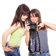 Two lovely friends with a camera - Stock Photo