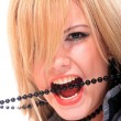 Woman open mouth and teeth biting - Stock Photo