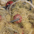 Fishing nets and buoys tackle - Stock Photo
