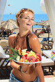 Young smiling woman with fruits salad — Stock Photo