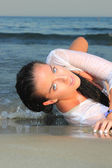 Photograph of a beautiful woman on the beach — Stock Photo