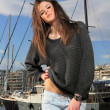 Young woman at the port - Foto Stock