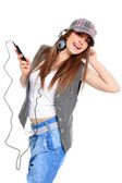 Cool teenager listening to music and dancing — Stock Photo