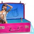 Young woman in bikini in a suitcase — Stock Photo