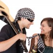Постер, плакат: Handsome young male and female musicians performers with guitar