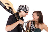 Handsome young male and female musicians, performers with guitar — Stock Photo