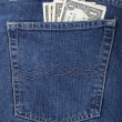 Money in a pocket of jeans — Stock Photo