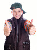Child hand gesturing thumb up — Stock Photo