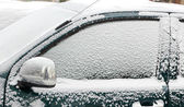 Snow covered car — Stock Photo