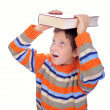 Stock Photo: Student child with a book on his head