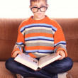 Young child sitting with book — Stock Photo