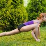 Slim woman doing yoga exercises — Stock Photo