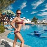 Slim woman near pool — Stock Photo