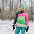 Snowboarding woman in forest — Stock Photo