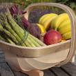 Stock Photo: Mixed bunch of fresh vegetables and fruit produce in basket outd
