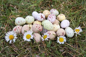 Easter eggs decorations outdoors on grass — Stock Photo