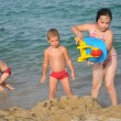 Happy children at the beach — Stock Photo