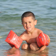 Stock Photo: Boy at sea learning to swim