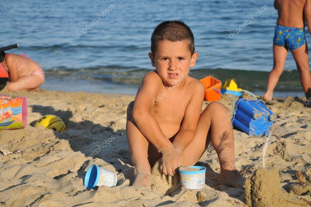 Happy young boy in the beach — Stock Photo #8339524