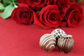 Engagement Ring and Chocolates — Stock Photo
