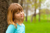 Portrait of smiling shy girl posing in the nature on beautiful spring day — Stock Photo