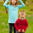 Stock Photo: Brother and sister posing outside on beautiful spring day