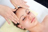 Beautiful young women getting a face massage — Stock Photo