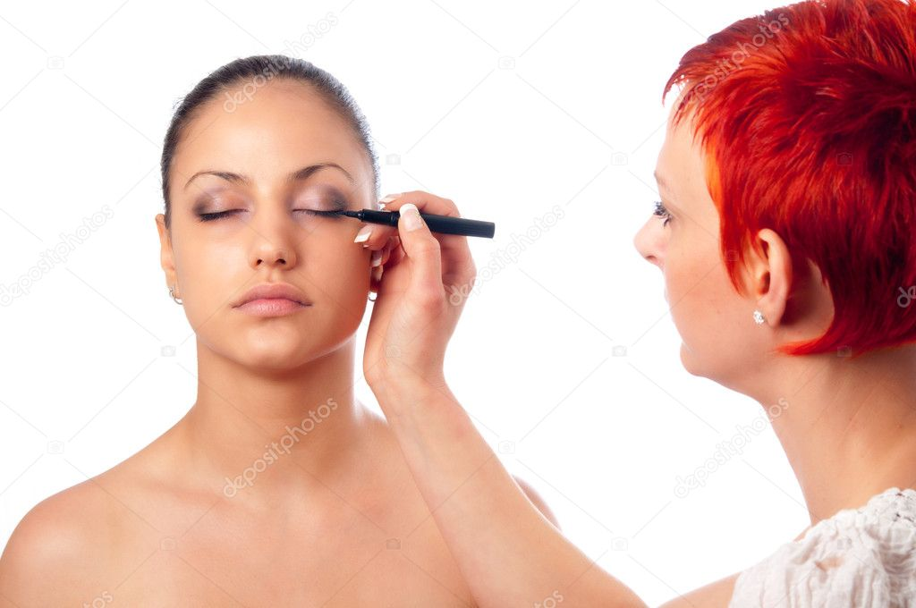 Makeup artist applying makeup on face of beautiful girl — Stock Photo #10463825