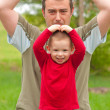 Father imitates his son while spending time in the park — Stock Photo #10577655