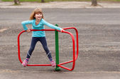 Cute little girl playing on the playground on beautiful spring day — Stock Photo