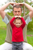 Father imitates his son while spending time in the park — Stock Photo