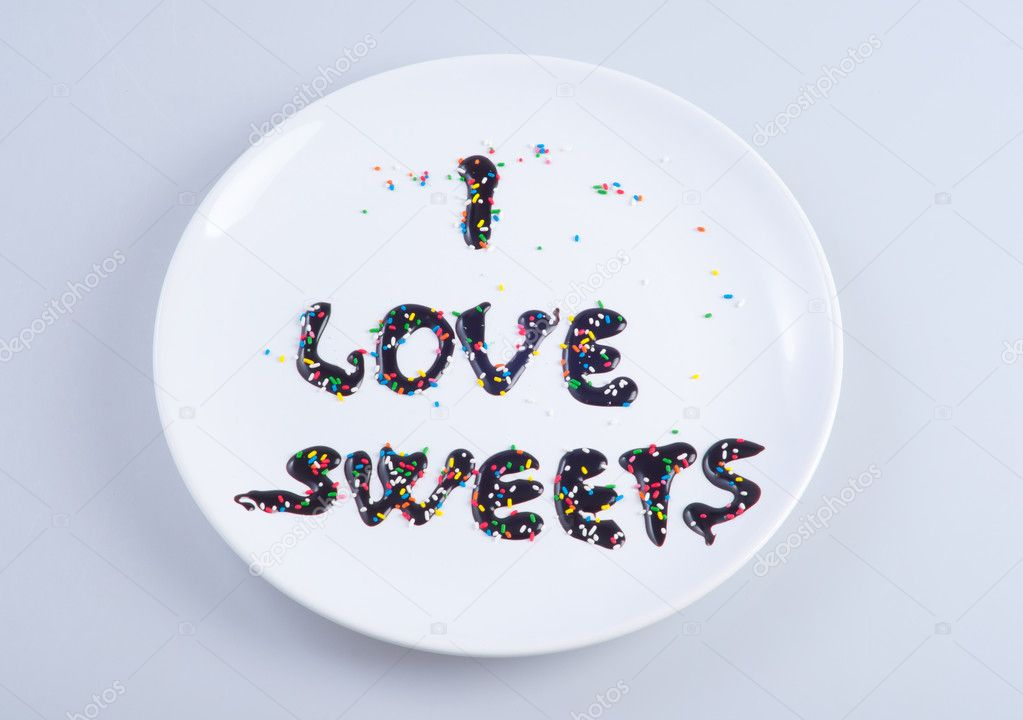 I love sweets written down with liquid chocolate — Stock Photo #10577514