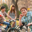 Happy teenage boy spending time with his friends riding bicycles — Stock Photo #10674766