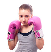 Portrait of pretty kick boxing girl with pink gloves — Stock Photo