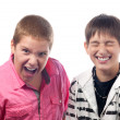 Two teenage boys laughing like crazy and kidding — Stock Photo