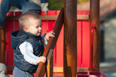 Portrait of the cute infant boy smiling on the playground — Stock Photo