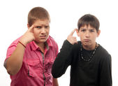 Two serious teenage boys showing on their heads — Stock Photo