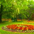 Landscape painting showing beautiful park with flower garden — Stock Photo