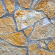Wall made of big colorful stones, suitable for background - Stock Photo