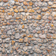 Wall made of small colorful stones, suitable as background - Stock Photo