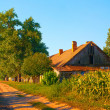 Beautiful country landscape showing old farm house on the sunny autumn day — Stock Photo