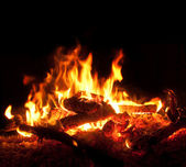 Flames in the fireplace from up close — Stock Photo