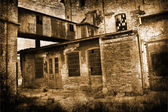 Art grunge background showing old abandoned house — Stock Photo